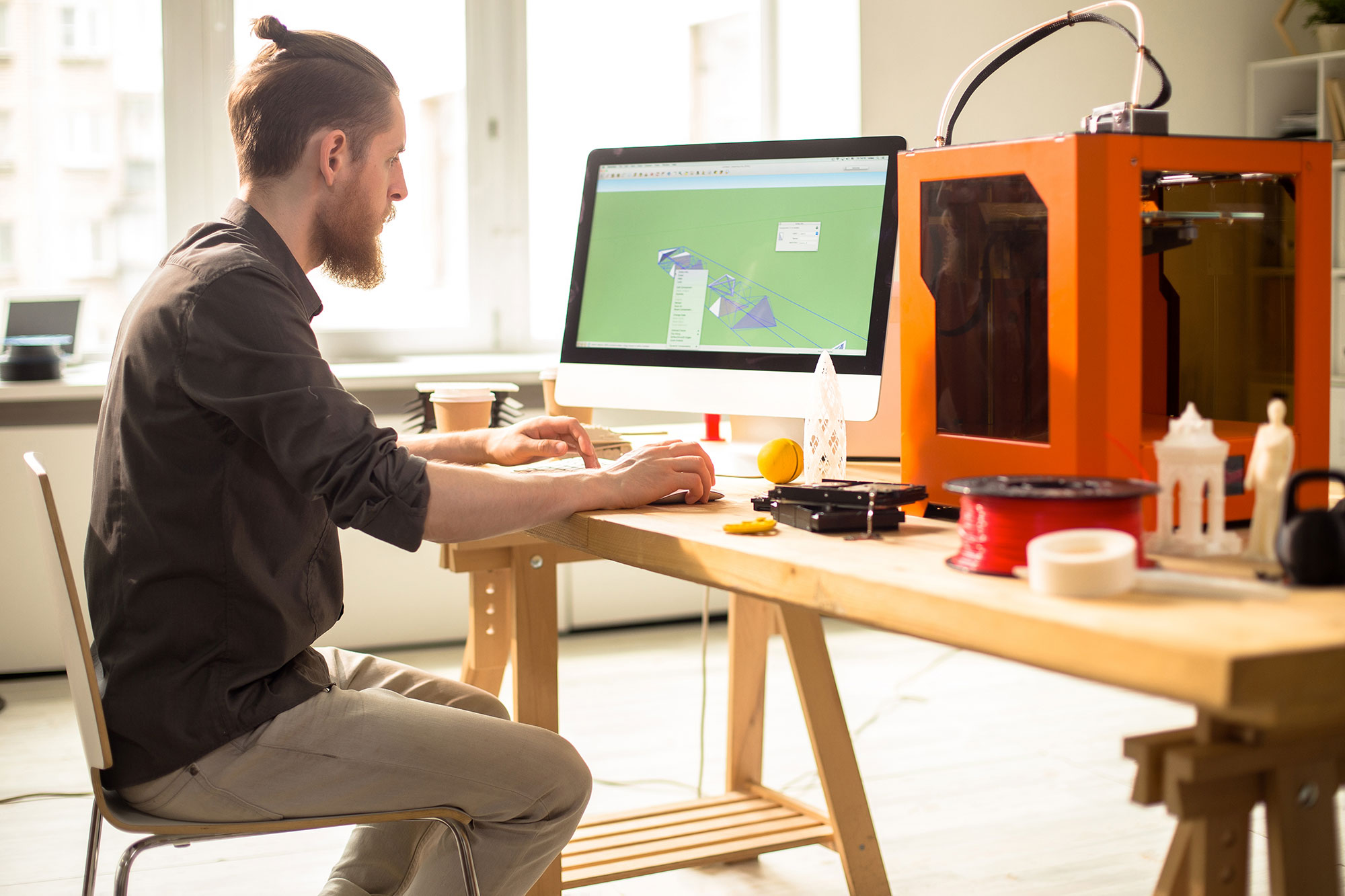 man working with 3D printer